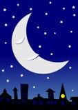 在困townscape的月亮 免版税库存图片