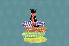 在围巾的逗人喜爱的猫坐枕头 皇族释放例证