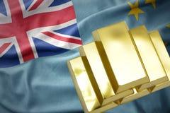 在图瓦卢旗子的光亮的金黄金块 免版税库存照片