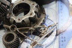 在图纸的齿轮 免版税图库摄影