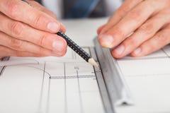 在图纸的建筑师图画 免版税库存照片