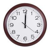 在圆的时钟的拨号盘的中午 免版税库存图片