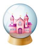 在圆顶里面的一座桃红色城堡 图库摄影