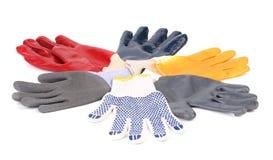 在圈子的不同的手套。 免版税库存照片