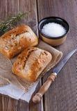 在土气木背景的Ciabatta面包 免版税库存照片