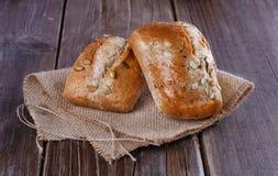 在土气木背景的Ciabatta面包 库存图片