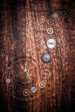 在土气木头的各种各样的时钟零件 免版税库存照片