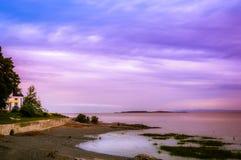 在圣劳伦斯河的日落在奥尔良海岛, 库存图片