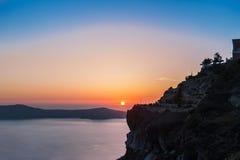 在圣托里尼海岛,希腊上的美好的日落 库存图片