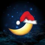 在圣诞前夕的月亮 免版税库存图片