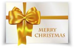 在圣诞快乐看板卡的金黄或黄色弓 免版税库存图片