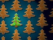 在圣诞树形状的姜饼与结冰的 免版税图库摄影