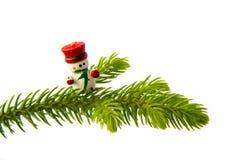 在圣诞树的雪人 免版税库存照片