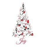在圣诞树的鸟 免版税库存图片
