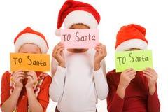 在圣诞老人上写字 免版税库存照片