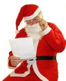 在圣诞老人上写字 免版税图库摄影