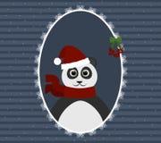 在圣诞老人帽子的熊猫在透雕细工框架 背景新年度 免版税库存图片