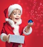 在圣诞老人打扮的小女孩 库存照片