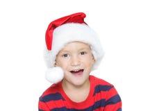 在圣诞老人白色的儿童愉快的辅助工 库存照片