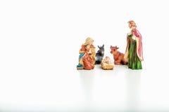 在圣诞节小儿床的圣洁家庭 库存照片