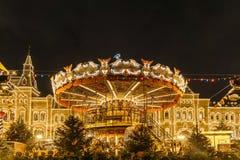 在圣诞节市场上的转盘在红场在莫斯科; 免版税库存照片