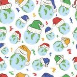 在圣诞节帽子无缝的纹理的行星 图库摄影