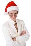 在圣诞节帽子的微笑的生意人 免版税库存照片