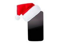 在圣诞节帽子的Smartphon 背景查出的白色 库存图片