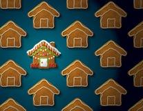 在圣诞节房子形状的姜饼有icin的 免版税库存照片