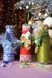 在圣诞节样式装饰的瓶 免版税库存照片