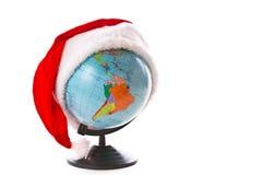 在圣诞节盖帽的地球 图库摄影