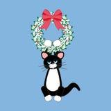 在圣诞节花圈的CAT 免版税库存照片