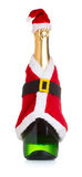 在圣诞节装饰圣诞老人的香宾瓶穿衣 免版税图库摄影