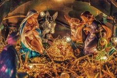 在圣诞节诞生场面的雕象 免版税库存照片