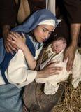 在圣诞节诞生的有同情心的手 库存照片