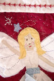 在圣诞节长袜的天使 免版税库存图片
