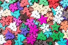 在圣诞节题材的木按钮  免版税图库摄影