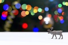 在圣诞节Bokeh背景的驯鹿 库存照片