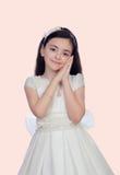 在圣餐打扮的可爱的小女孩 库存图片