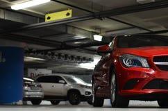 在地下停车处的汽车 免版税库存照片