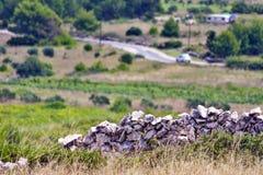 在地中海文化的老石墙 库存照片