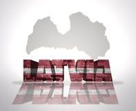 在地图背景的词拉脱维亚 免版税库存图片