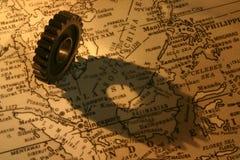 在地图(东南亚国家联盟地区)的齿轮 图库摄影