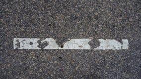 在地板上的一条空白线路 免版税库存照片