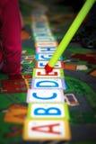 在地板上的字母表在幼儿园 免版税库存图片