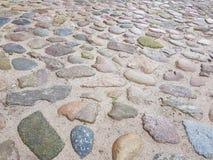 在地板上的小棕色石头在施托尔科市  免版税库存照片