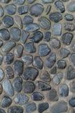 在地板上的许多小卵石岩石 免版税库存图片