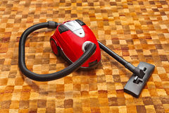 在地毯的吸尘器 免版税库存图片