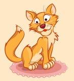 在地毯的姜猫 免版税库存照片