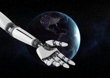 在地球前面的机器人手反对黑背景 库存图片